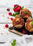 Fresh muffins with raspberry on a rustic table for breakfast. Still life, food and drink, breakfast concept. Fresh homemade muffins with raspberry on a rustic Stock Photos