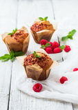 Fresh muffins with raspberry on a rustic table for breakfast Royalty Free Stock Photo