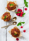 Fresh muffins with raspberry on a rustic table for breakfast Royalty Free Stock Photos