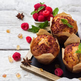 Fresh muffins with raspberry on a rustic table for breakfast. Still life, food and drink, breakfast concept. Fresh homemade muffins with raspberry on a rustic Royalty Free Stock Photography