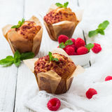 Fresh muffins with raspberry on a rustic table for breakfast Stock Photography