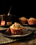 Fresh muffins under sugar powder stock images