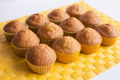 Fresh  muffins on yellow napkin Stock Images