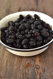 Fresh mulberry in the enameled bowl Stock Photo