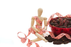 Fresh mulberry and measure tape Royalty Free Stock Photo