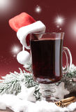 Fresh mulled wine with hat. Fresh mulled wine with christmas hat Royalty Free Stock Photography