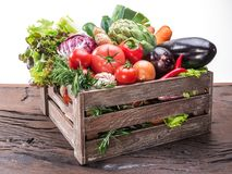 Fresh multi-colored vegetables in wooden crate. stock images