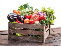 Fresh multi-colored vegetables in wooden crate. royalty free stock photo
