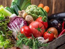 Fresh multi-colored vegetables in wooden crate. Stock Photography