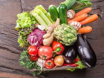 Fresh multi-colored vegetables in wooden crate. Top view. Stock Photo