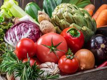 Fresh multi-colored vegetables in wooden crate. Top view. stock photography