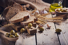 Fresh Multigrain Crusty Bread, Green Olives And Wheat Ears On A Stock Photography