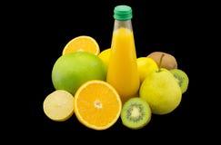 Fresh multivitamin juice. Isolated on black background Stock Photos