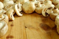 Fresh mushroom on wooden Royalty Free Stock Image