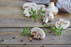 Fresh mushrooms and basil on rustic wooden background. Natural homemade food concept Stock Images