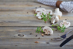 Fresh mushrooms and basil on rustic wooden background. Natural homemade food concept Stock Photo