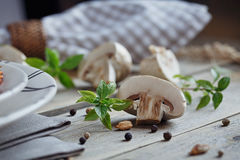 Fresh mushrooms and basil on rustic wooden background. Natural homemade food concept Royalty Free Stock Image
