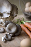 Fresh mushrooms on a chopping block royalty free stock images
