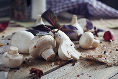Fresh mushrooms and garlic on wooden background. Fresh mushrooms and garlic on rustic wooden background Royalty Free Stock Photos