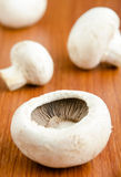 Fresh mushrooms on kitchen table Stock Photo