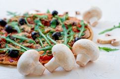 Free Fresh Mushrooms On The White Table  With Free Copy Space On The Right Side. Veggie Pizza With Vegetables, Olives, Rucola Stock Image - 110537661