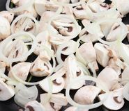 Fresh mushrooms with onions. Some fresh white mushrooms with onions Royalty Free Stock Images