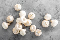 Fresh mushrooms. Raw mushrooms on wooden board. Champignons Stock Photo