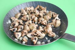 Fresh mushrooms. Some fresh cooked mushrooms with cream and onions in a pan Royalty Free Stock Photos