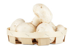 Fresh mushrooms in a wooden box Royalty Free Stock Images