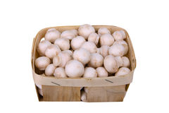Fresh mushrooms in a wooden box on white Royalty Free Stock Photos