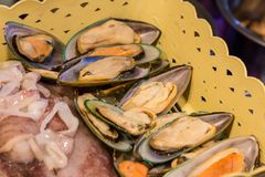 Fresh mussels in basket. Fresh mussels and squid in basket Royalty Free Stock Images