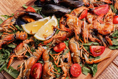 Fresh mussels, crayfish, shrimp. Seafood platter Stock Photography