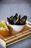Fresh Mussels in a simple white bowl Royalty Free Stock Image