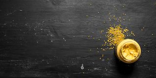 Fresh mustard in jar with seeds. Royalty Free Stock Image