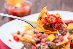 Fresh Nachos on a fork Stock Images