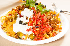 Fresh nachos and vegetable salad with meat. Chili con carne  ,tipycal mexican food Royalty Free Stock Photo