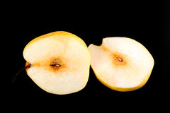 Fresh nashi pear and  cut on black background Stock Images