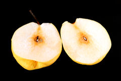 Fresh nashi pear and  cut on black background Royalty Free Stock Image