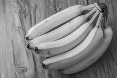 Fresh natural banana bunch Black and white style. Fresh and natural banana Tabasco on wood table, black and white style Stock Images