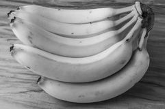 Fresh natural banana bunch Black and white style. Fresh and natural banana Tabasco on wood table, black and white style Royalty Free Stock Photos