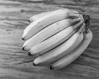 Fresh natural banana bunch Black and white style. Fresh and natural banana Tabasco on wood table, black and white style Royalty Free Stock Image