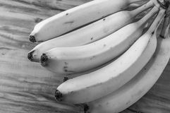 Fresh natural banana bunch Black and white style. Fresh and natural banana Tabasco on wood table, black and white style Royalty Free Stock Photography