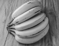 Fresh natural banana bunch Black and white style. Fresh and natural banana Tabasco on wood table, black and white style Stock Photo