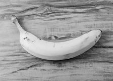 Fresh natural banana bunch Black and white style. Fresh and natural banana Tabasco on wood table, black and white style Stock Image