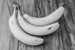 Fresh natural banana bunch Black and white style. Fresh and natural banana Tabasco on wood table, black and white style Stock Photos