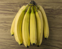 Fresh natural banana bunch. Fresh and natural banana Tabasco on wood table Royalty Free Stock Image