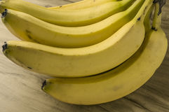 Fresh natural banana bunch. Fresh and natural banana Tabasco on wood table Royalty Free Stock Images