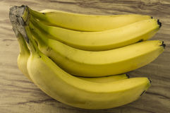 Fresh natural banana bunch. Fresh and natural banana Tabasco on wood table Stock Images
