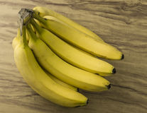 Fresh natural banana bunch. Fresh and natural banana Tabasco on wood table Royalty Free Stock Photos