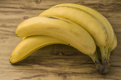 Fresh natural banana bunch. Fresh and natural banana Tabasco on wood table Stock Image